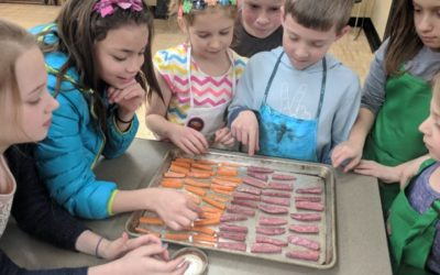 Hey Mikey, you'll like it: Cooking a meal might help get kids to eat different foods